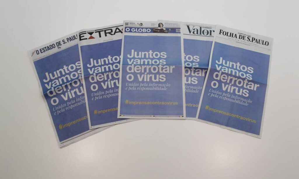 capas de jornal em cima de uma mesa - propósito de marca e a crise do coronavirus